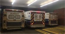 3 Summit ambulances at the Overlook Medical Center emergency entrance.