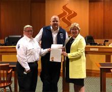 John Buscaino and Kari Phair accept the Proclamation from Mayor Radest (J. Staunton photo)