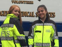 Squad Junior Members  Kaitlin Shimek and Kelly Collins in the new EMS jackets