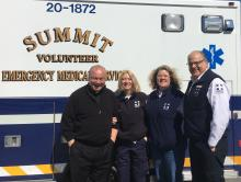 Msgr Bob Meyer, thanks volunteers Denise Barber, Bevely Brown and John Buscaino